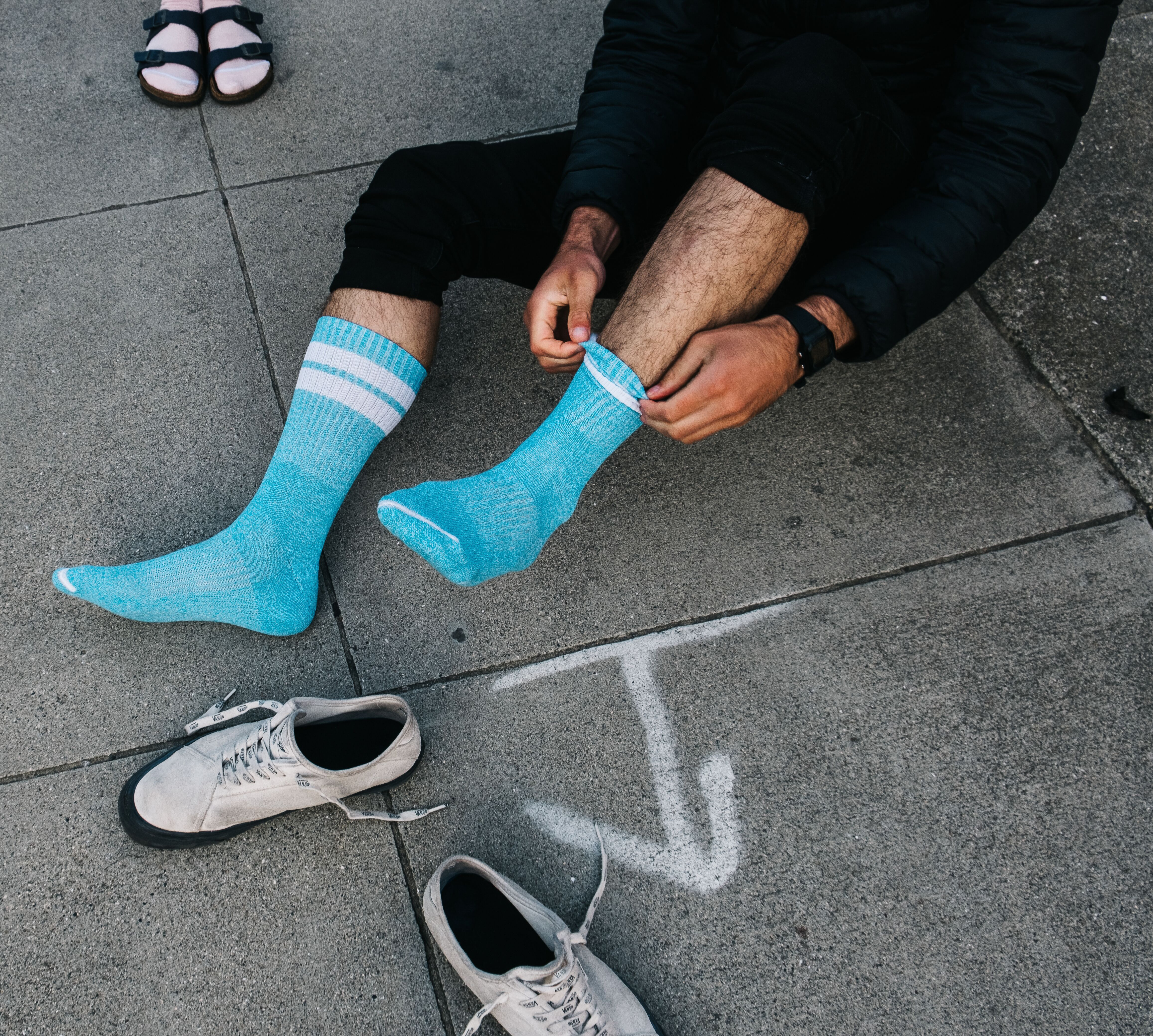Man putting on Arvin Goods gym socks