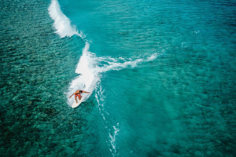 Chef Dario Tani surfing