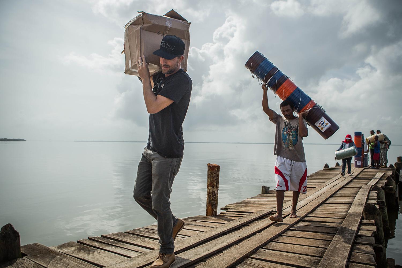 Jon Rose carrying water filters