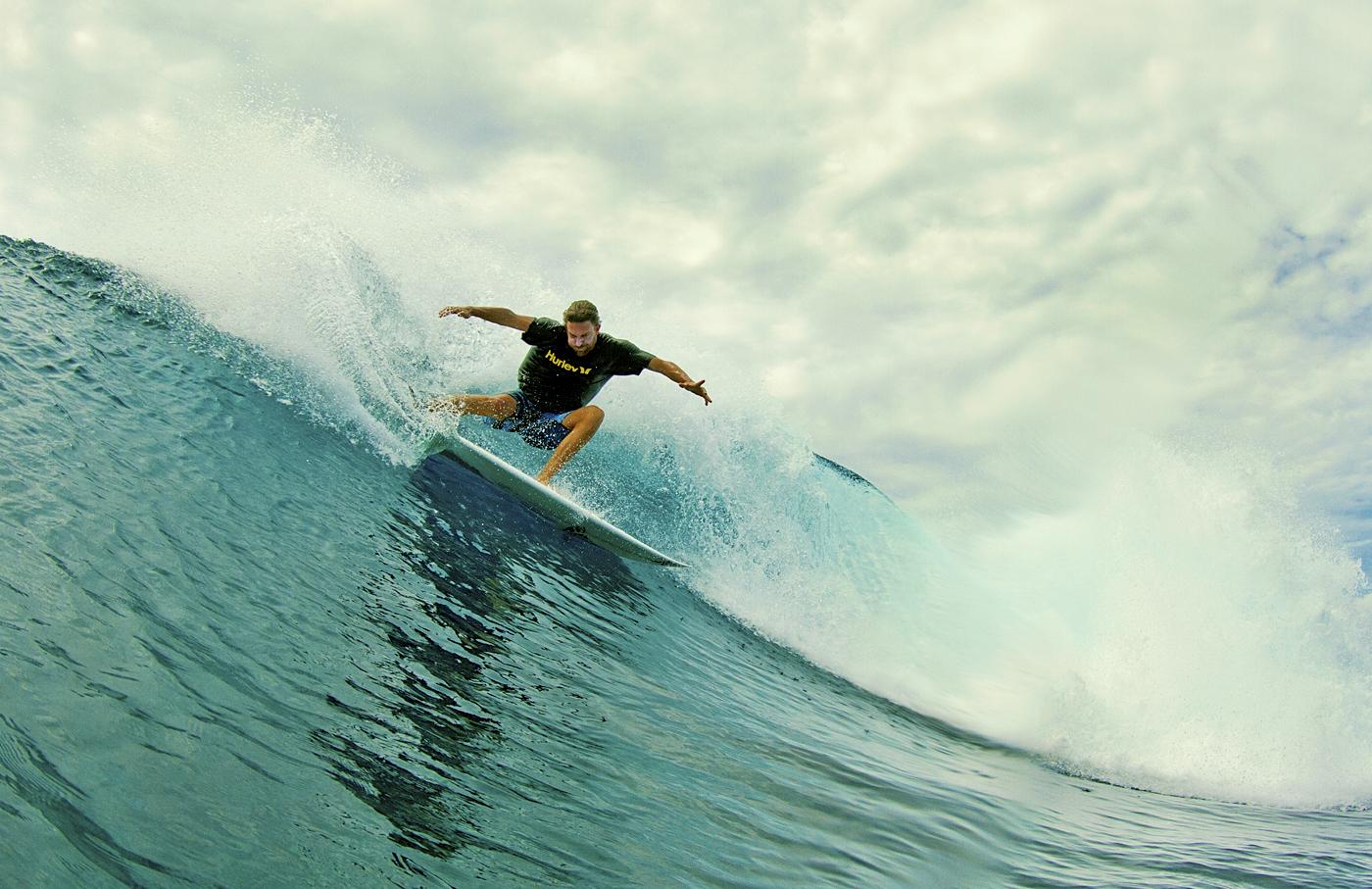 Jon Rose surfing