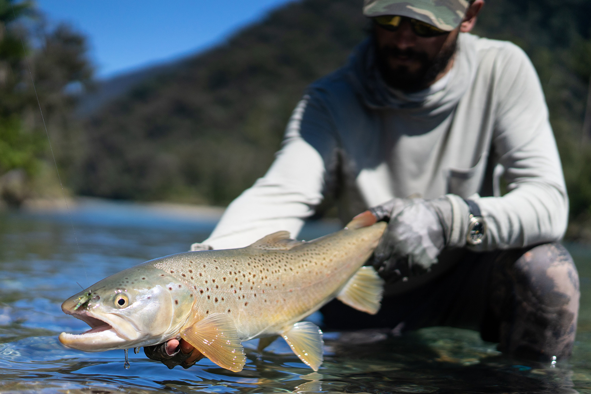 Mike Idell catching fish in New Zealand