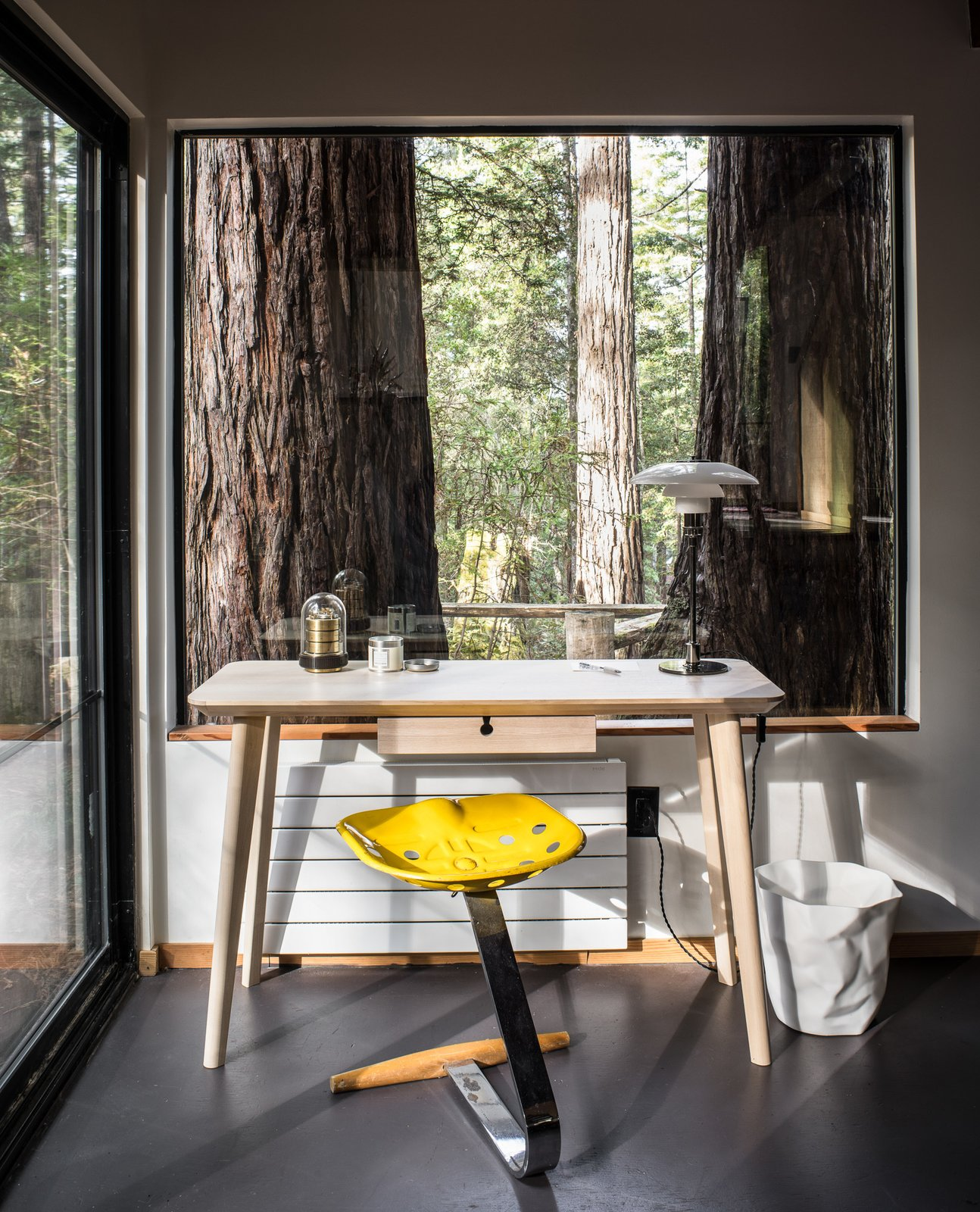 A small office space overlooks the redwood surroundings.