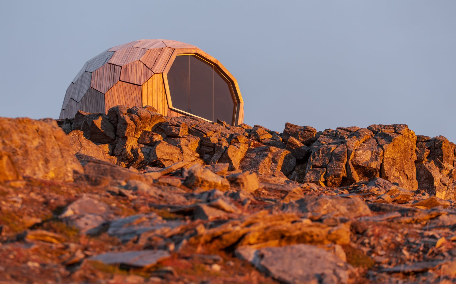 Fitting in seamlessly with the fabric of the natural landscape, the cabin makes a modest impact in scale, while providing a functional benefit to travelers in the region.