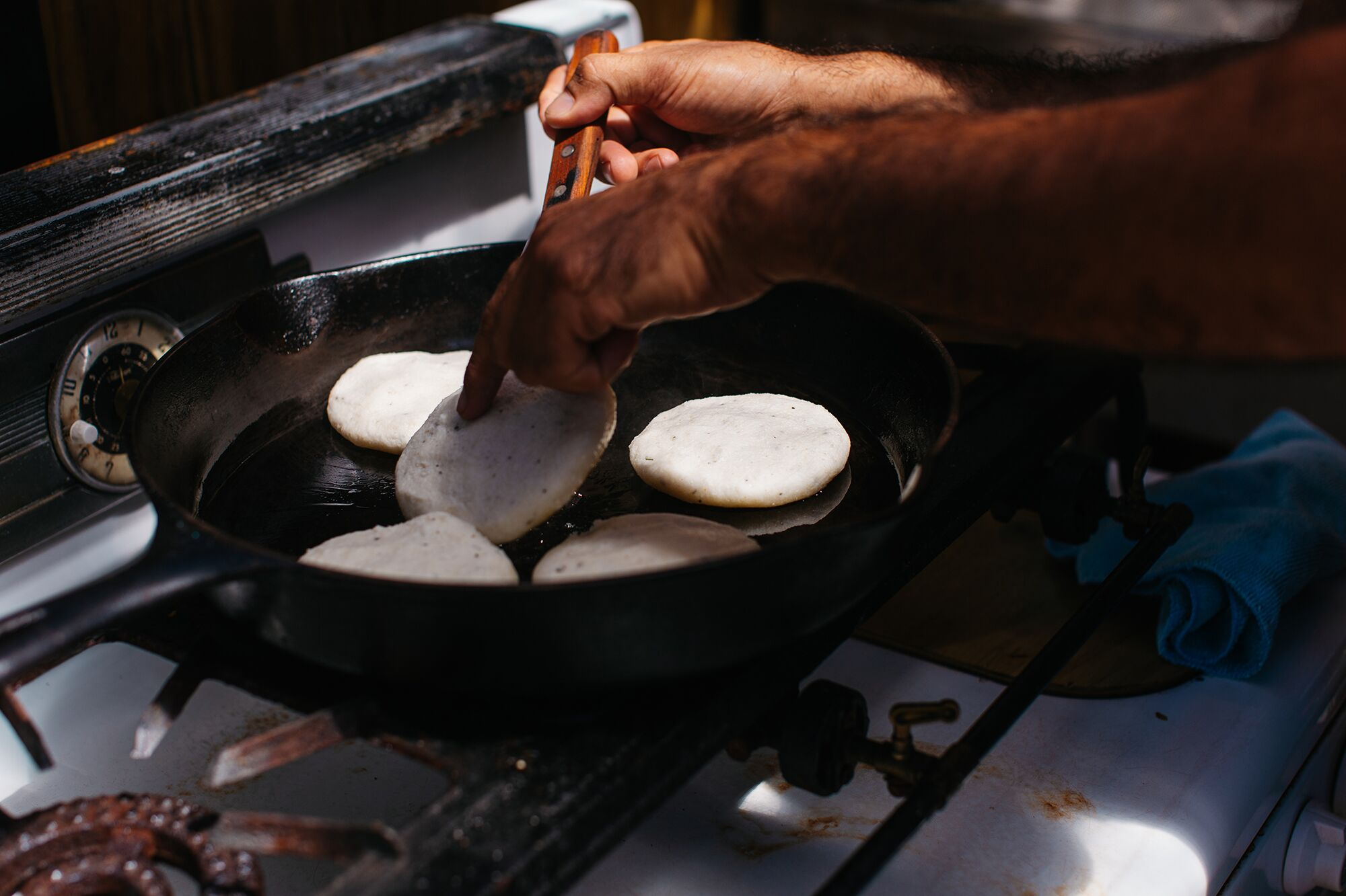 Arepas on a cast iron pan