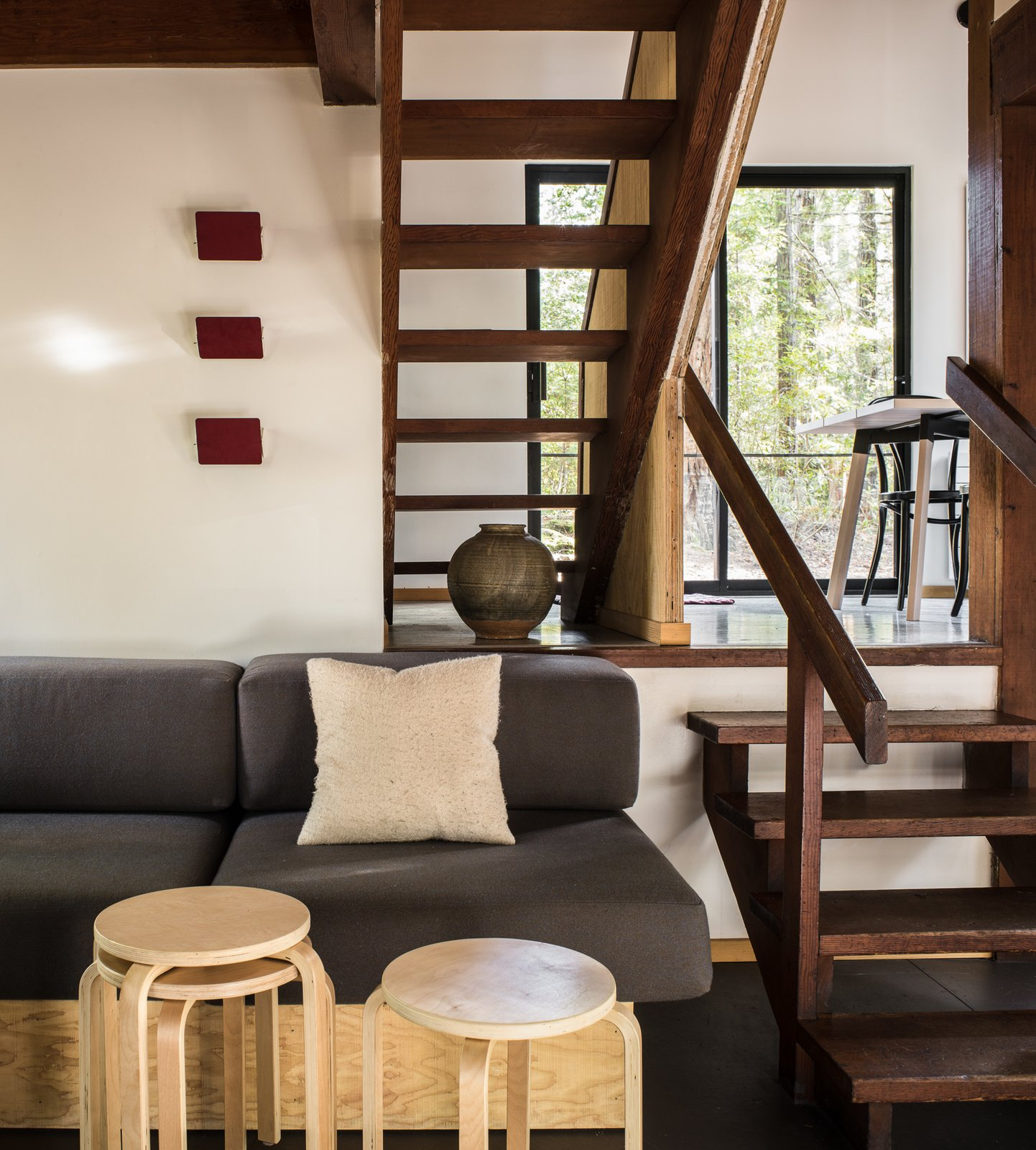 Open wood stairs allow light to pass between levels.